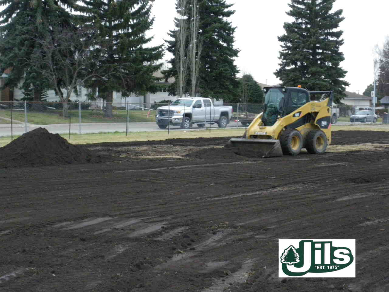 Bobcat moving topsoil